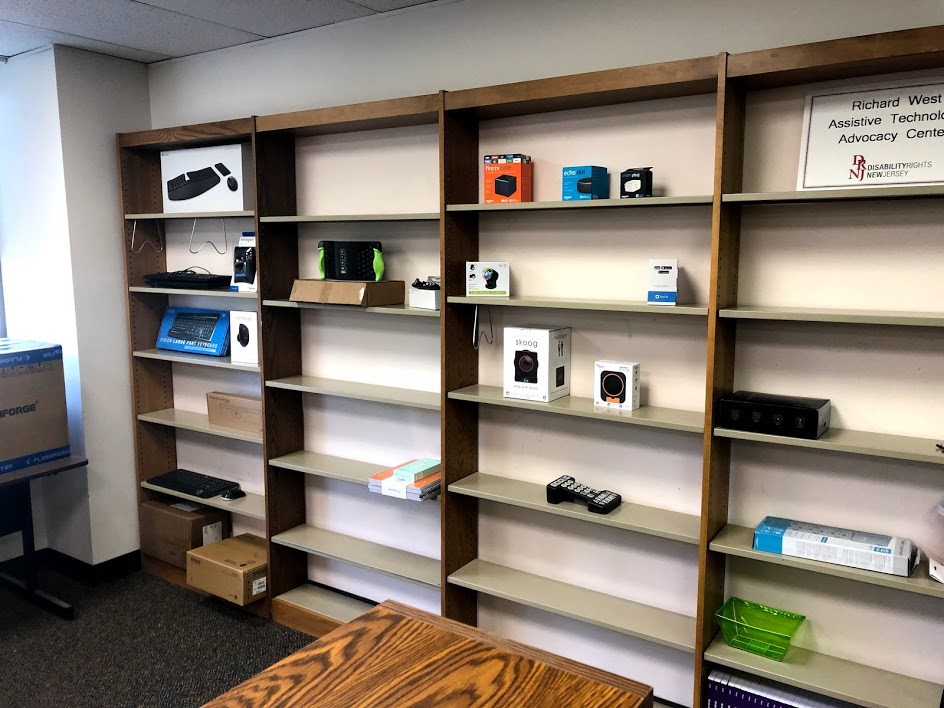 Display shelves with an array of assistive technology tools ready to be loaned to a NJ resident!